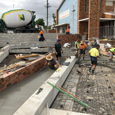 Concrete slabs being poured in the courtyard