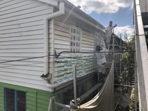 Chemical stripper being used to remove lead-based paint