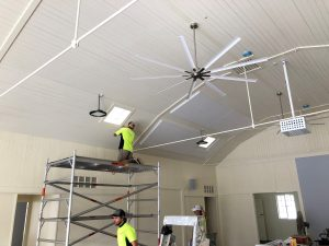 Acoustic panels being fixed to hall ceiling